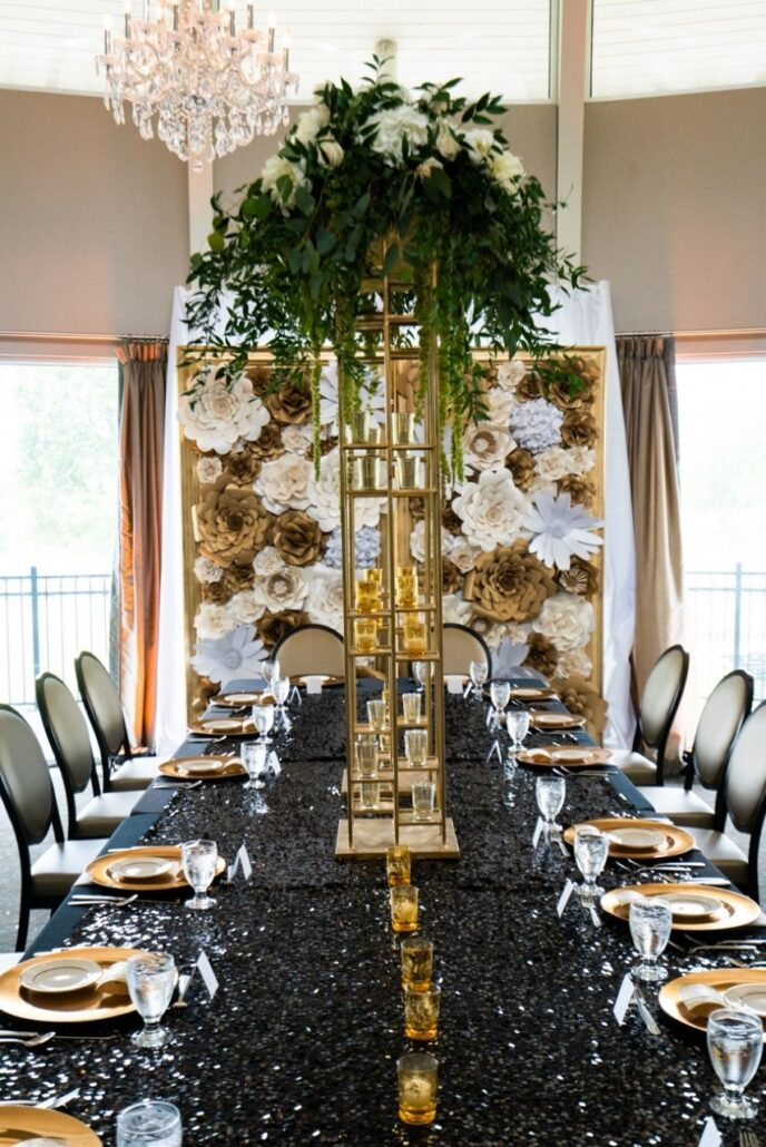 black sequin tablecloth and gold centerpieces