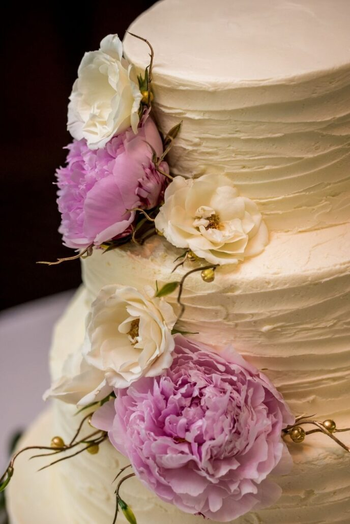 wedding cake with pink and white peonies