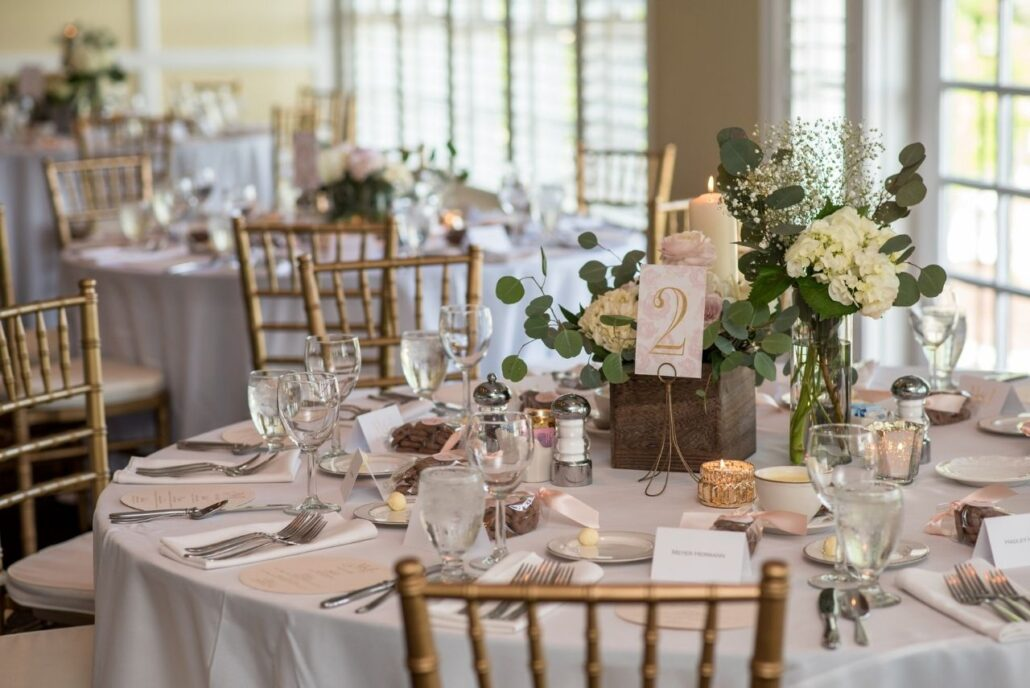 soft blush and greenery reception centerpiece evansville country club