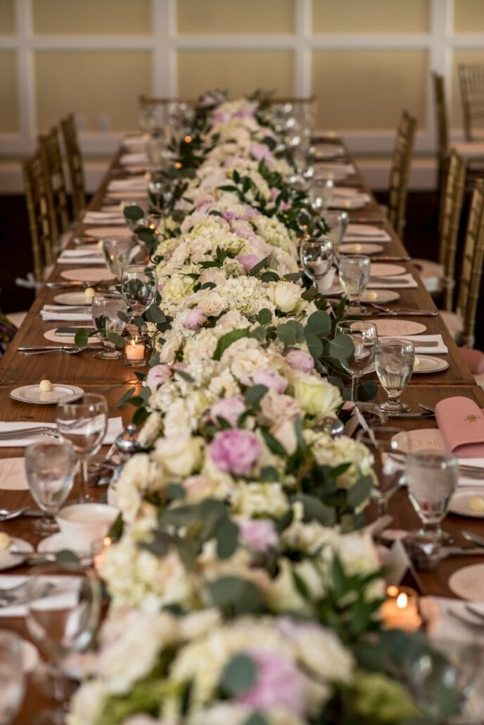 floral garland on harvest table at evansville country club