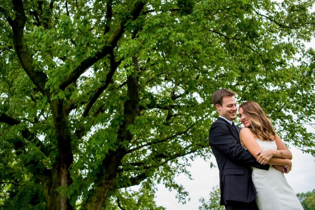 wedding couple outside with trees