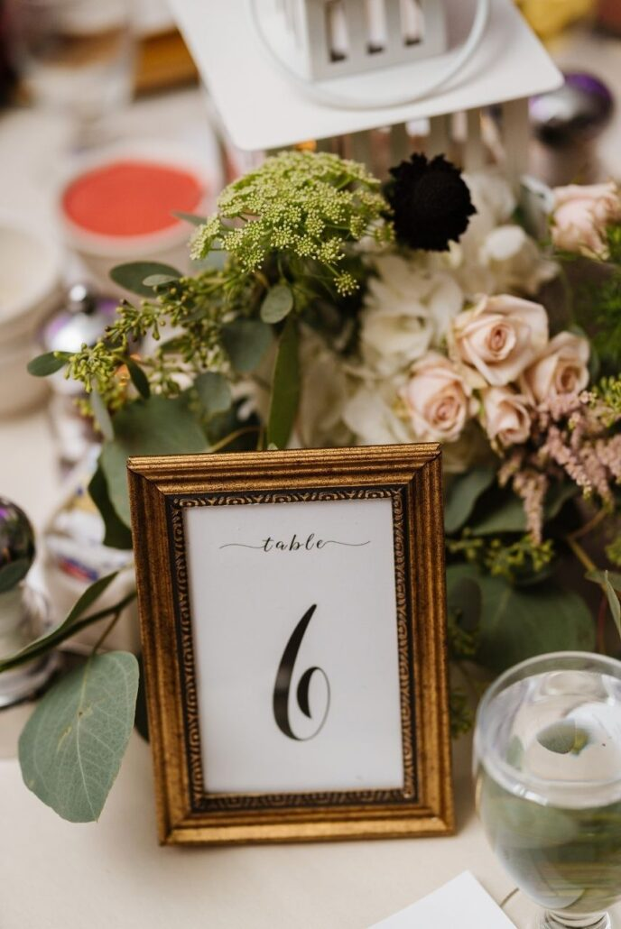gold table numbers with floral centerpiece evansville country club wedding