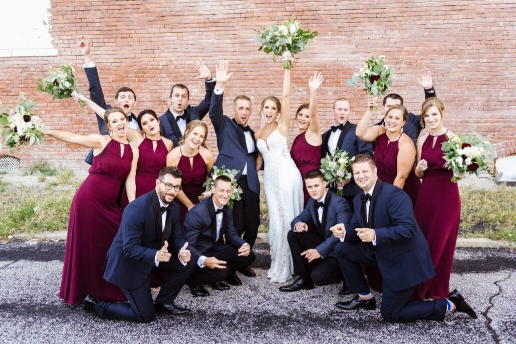 bridal party cranberry dresses and navy suits