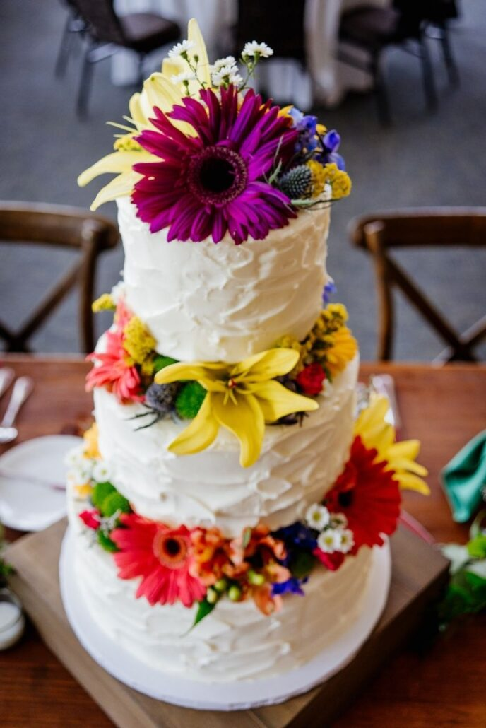 three tier wedding cake with colorful flowers