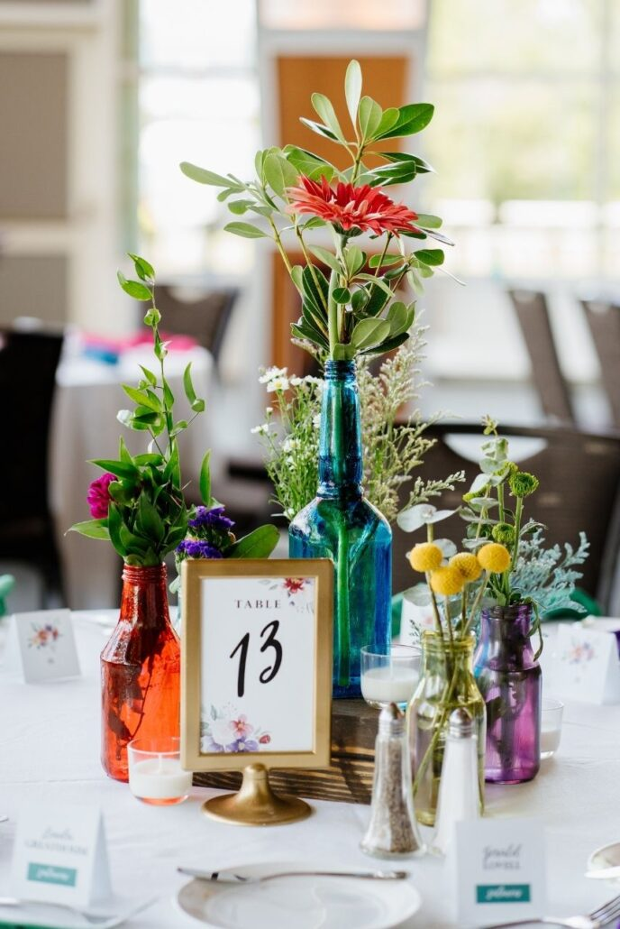colorful vases and flowers at wedding reception