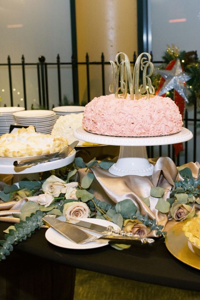 wedding dessert table of cakes and pies