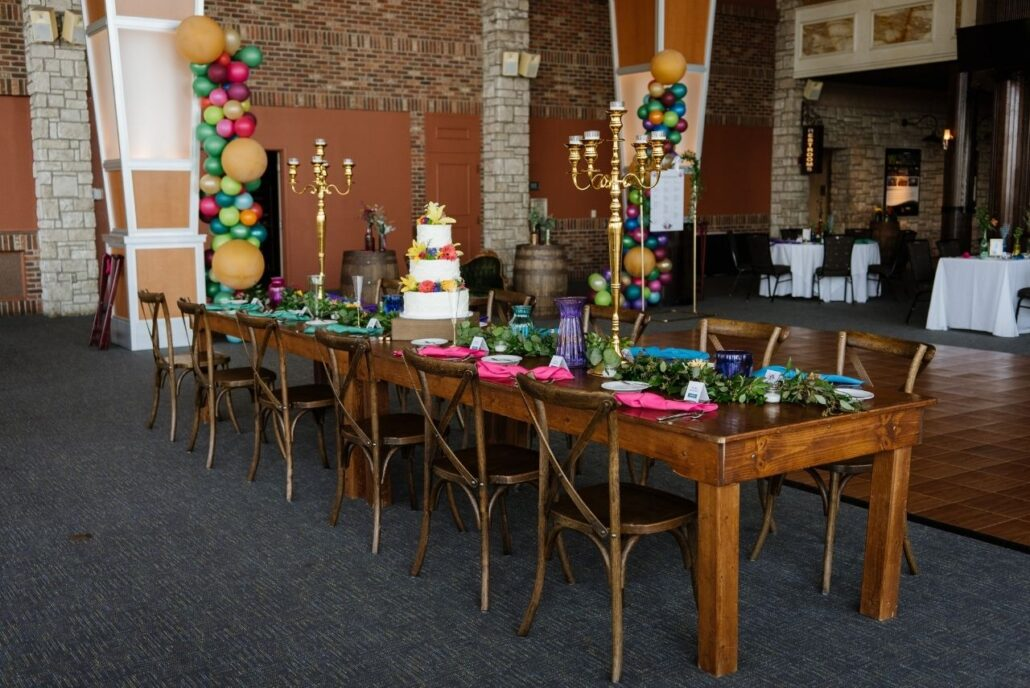 harvest table at wedding with colors
