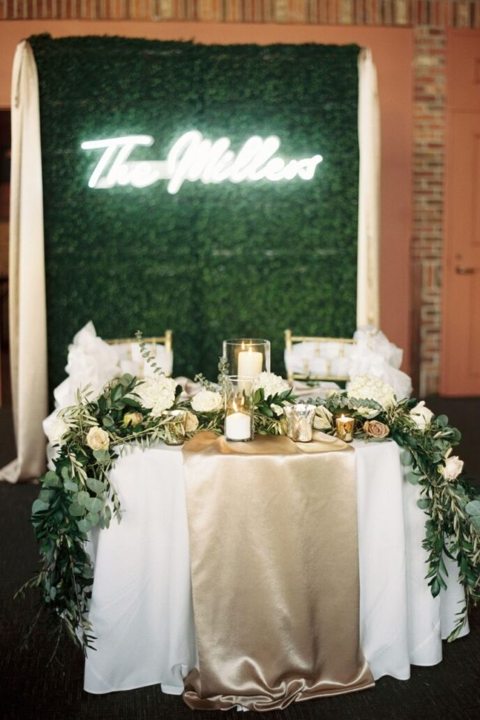 grass wall backdrop in front of sweetheart table