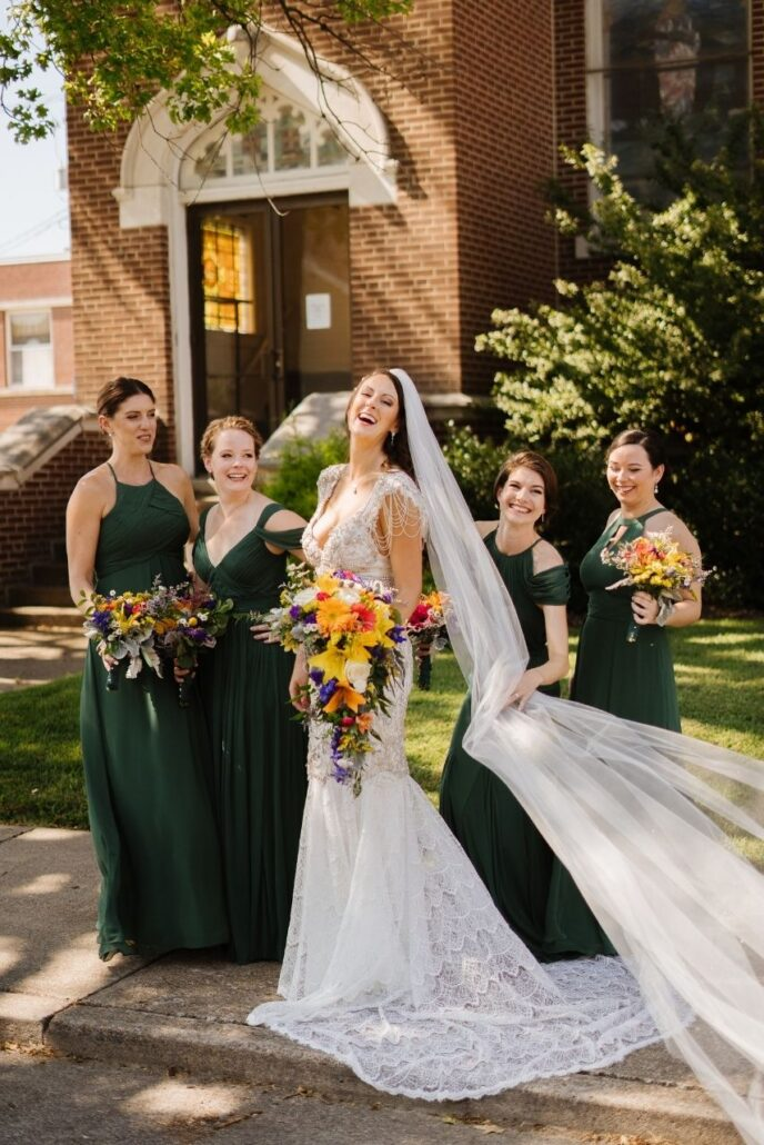 laughing wedding bridal party