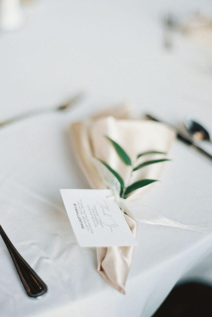 cream satin napkin fold with card