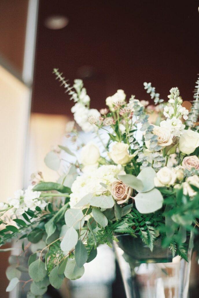 tall centerpiece with eucalyptus white flowers