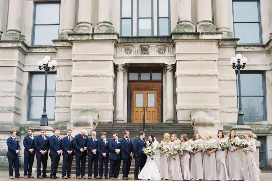 large wedding party with soft colors