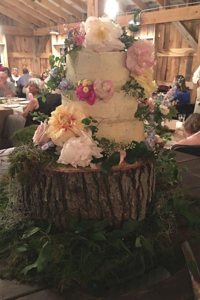 wedding cake on wood log